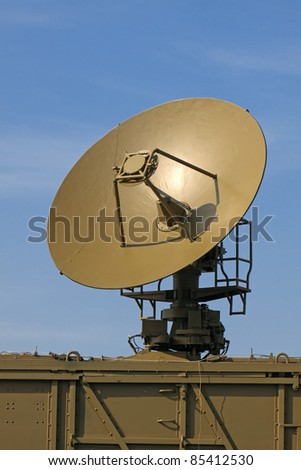 The military aerial of a radar against the blue sky - stock photo