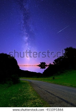 The Milky Way and a Perseid meteor over the Salt Fork region of Guernsey county, Ohio. - stock photo