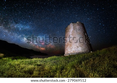 The milky way behind an acient watchtower  - stock photo