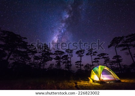 the milky way in front of a tent - stock photo