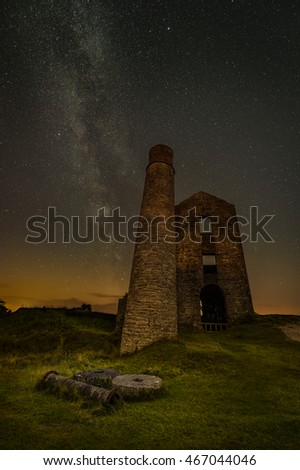 The Milky Way over the derelict buildings of Magpie Mine in Derbyshire. The light pollution on the horizon is from the city of Sheffield.