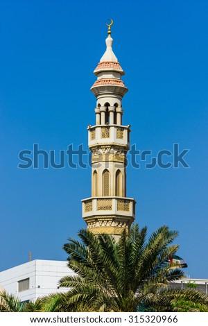 The minaret of a mosque in Dubai - stock photo