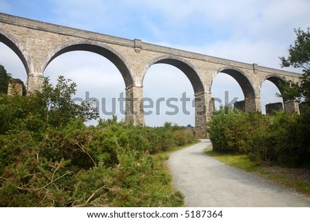 The mineral tramways cost to cost trail cycle path passing underneath the Carnon stone viaduct, built in 1933. - stock photo