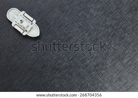 The miniature of retro plastic steam ship toy model represent the ship and water transportation concept related idea. - stock photo