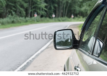 the mirror of a car on the road background