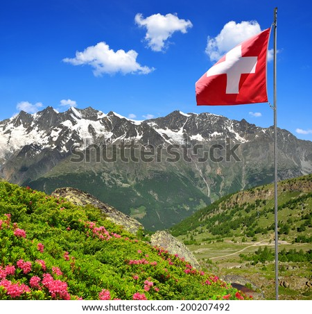 The Mischabel group with Swiss flag - Swiss alps  - stock photo