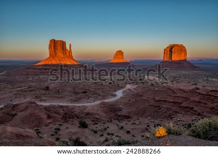 The Mittens in Monument Valley at sunset - stock photo