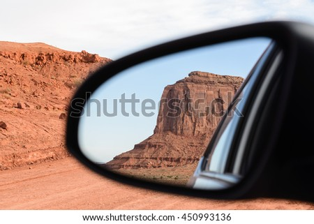 The mittens, Mesa, view from rear mirror at Monument Valley, Navajo Tribal Park, Arizona USA - stock photo