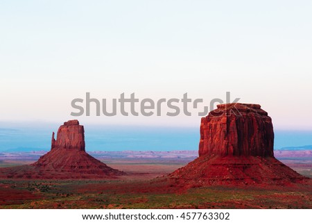 The Mittens rock formation at sunset in the Monument Valley in Arizona. - stock photo