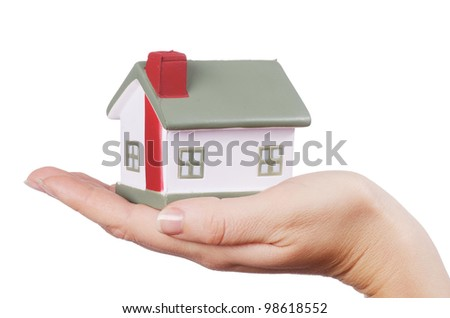 The model house in female hands isolated