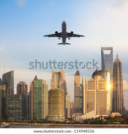 the modern building with airliner at dusk in shanghai, China. - stock photo