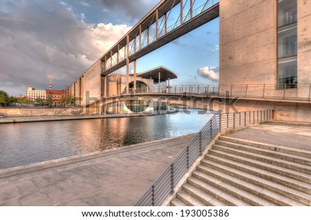 The modern government buildings that cross the River Spree in Berlin. - stock photo