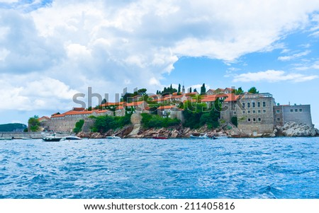 The modern luxury hotel complex of Sveti Stefan islet looks like the medieval fortress, Montenegro. - stock photo