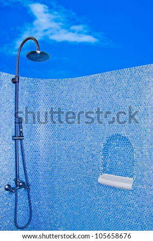 The Modern shower head in restroom isolated on blue sky background - stock photo
