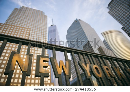 The modern skyscrapers of Downtown Manhattan New York City skyline tower into blue sky - stock photo