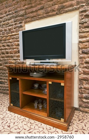 The modern TV on a background of a stone wall - stock photo