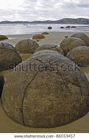 The Moeraki Boulders on Koekohe Beach on the Otago coastline of the South island of New Zealand - stock photo