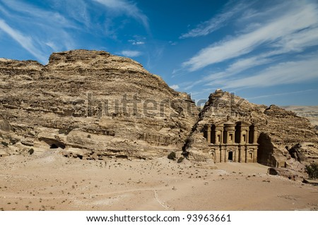 The Monastery (al-Deir or ad-Dayr in Arabic), a Nabatean structure from the 1st century BC, dominates the crest of a mountain north of Petra's city center. - stock photo