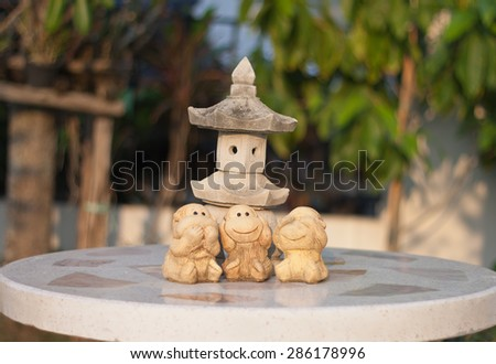the monkey dolls are molded using hand action close ears,eyes and mouth for decorate garden - stock photo