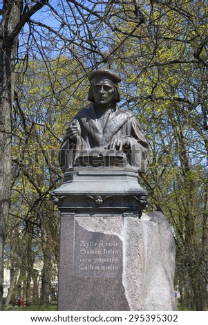 The monument to the Mikael Agricola - the founder of the Finnish literature Sunny may day. Vyborg - stock photo