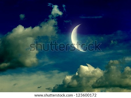 The moon in the night sky in clouds - stock photo