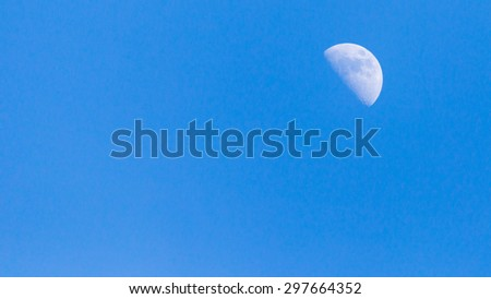 the moon in the sky at dawn - stock photo