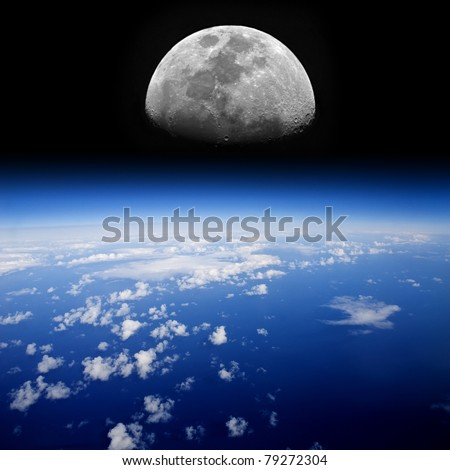 The Moon rises over planet Earth.