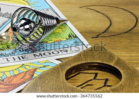 the moon shown by fortune telling accessories - stock photo