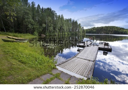 The mooring on the forest lake.  - stock photo
