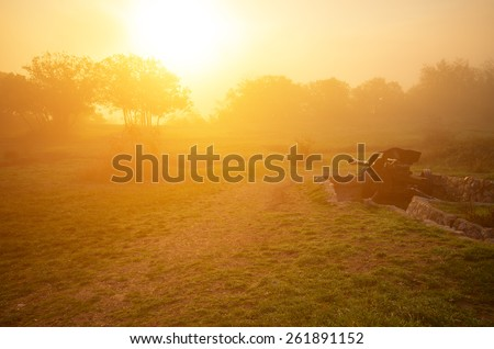 The morning before the fight. Early foggy morning and the bright sun in the background - stock photo