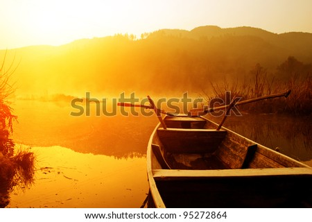 The morning of the lake, the boat docked in the lake. - stock photo