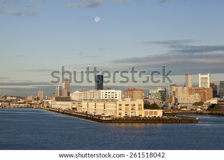 The morning view of Boston downtown with the full Moon (Massachusetts). - stock photo