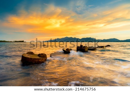 The mortar wave hit in the twilight front island .Gold backgrounds textures - stock photo