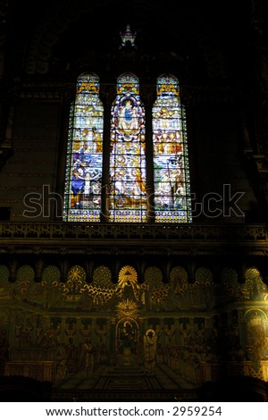 The mosaic window and wall in basilique Notre Dame de Fourviere, Lyon, France. - stock photo
