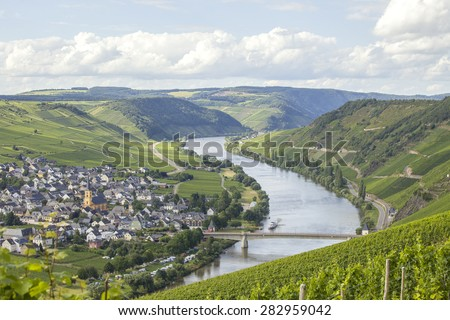 The Mosel river near Cochum in Germany with its vineyards - stock photo