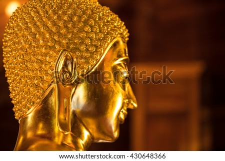 The Most Beautiful Golden Buddha ; Close up of Gold face Buddha statue at public worship, Thailand - stock photo