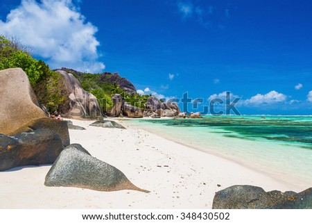 The most beautiful paradise beach with white sand by the Indian ocean on Seychelles and Mauritius - stock photo