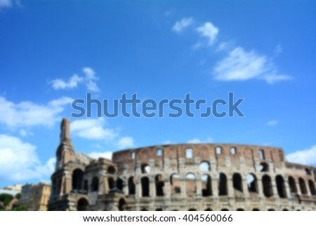 The most famous monument of Rome, the Colosseum, Italy, for a roman background; defocused and blurry effect intentional. - stock photo