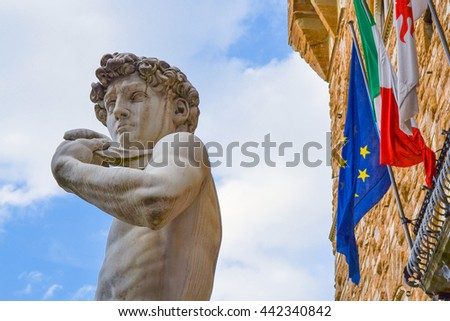 The most famous statue in Florence, David of Michelangelo, Italy. With italian european flags. Brexit. - stock photo