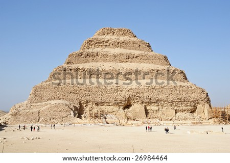 The most prominent ancient ruin at Sakkarah is the step pyramid of Zoser, the pharaoh who  founded the IIIrd dynasty. - stock photo
