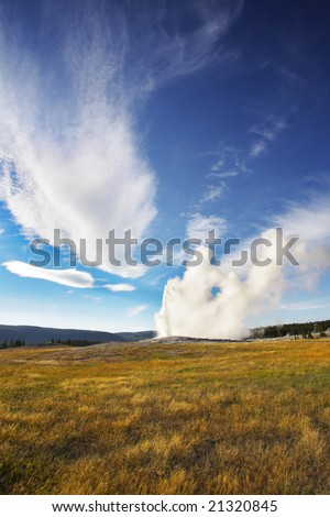 The most well-known of the world geyser in Yellowstone national park - Old Faithful. - stock photo