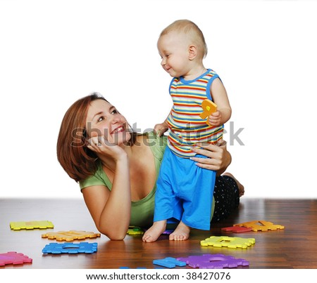The mother is playing with her child