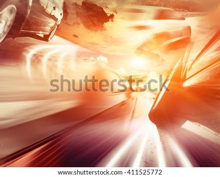 The motion blurred car on asphalt road - stock photo