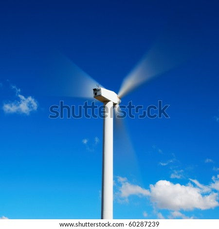 The motion of a wind turbine viewed from behind - stock photo