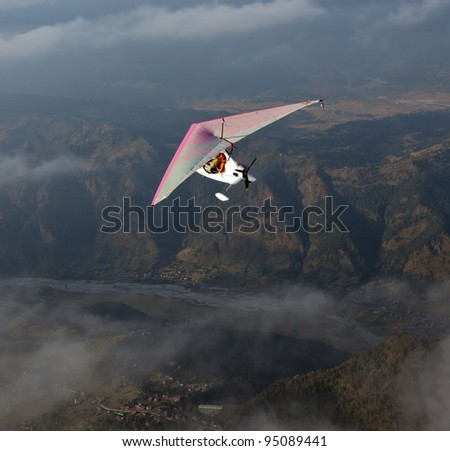 The motor hang-gliding in the sky near the Pokhara- Nepal - stock photo
