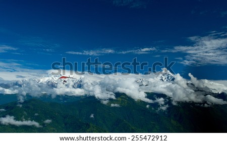 The motor hang-gliding in the sky - Nepal - stock photo