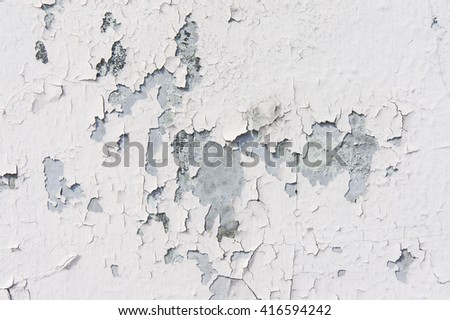 The mottled and crack white cement wall - stock photo