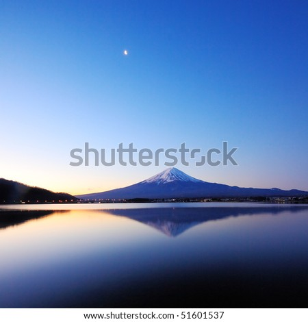 the mountain Fuji at dawn with peaceful lake reflection - stock photo