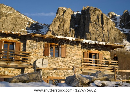 The mountain hut at sunrise - stock photo