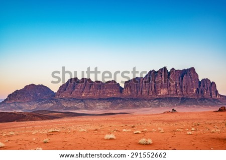 The Mountain of Wadi Rum in Jordan at the twilight hour. Wadi Rum is known as The Valley of the Moon and has led to its designation as a UNESCO World Heritage Site.